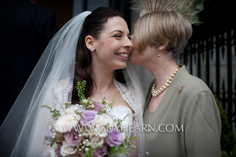 mother and bride kiss wedding photo