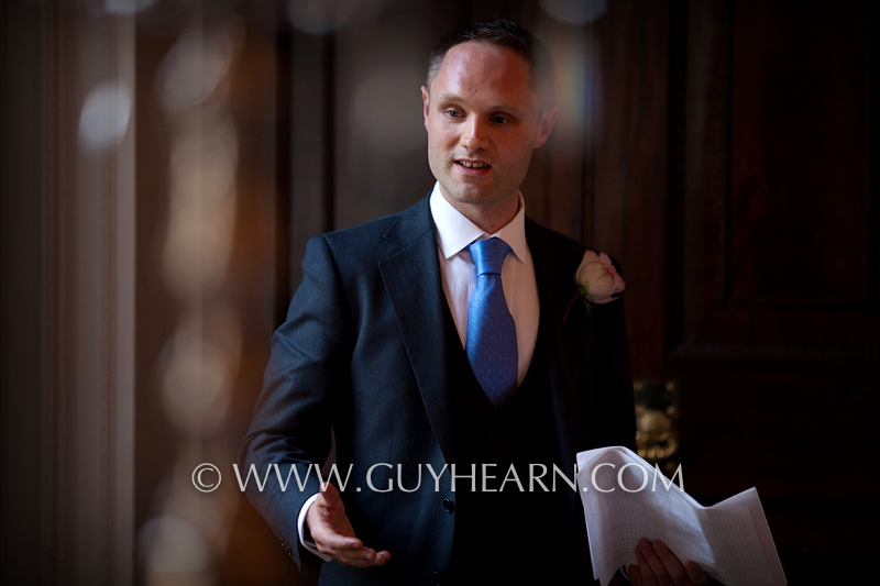 groom blue tie giving speech